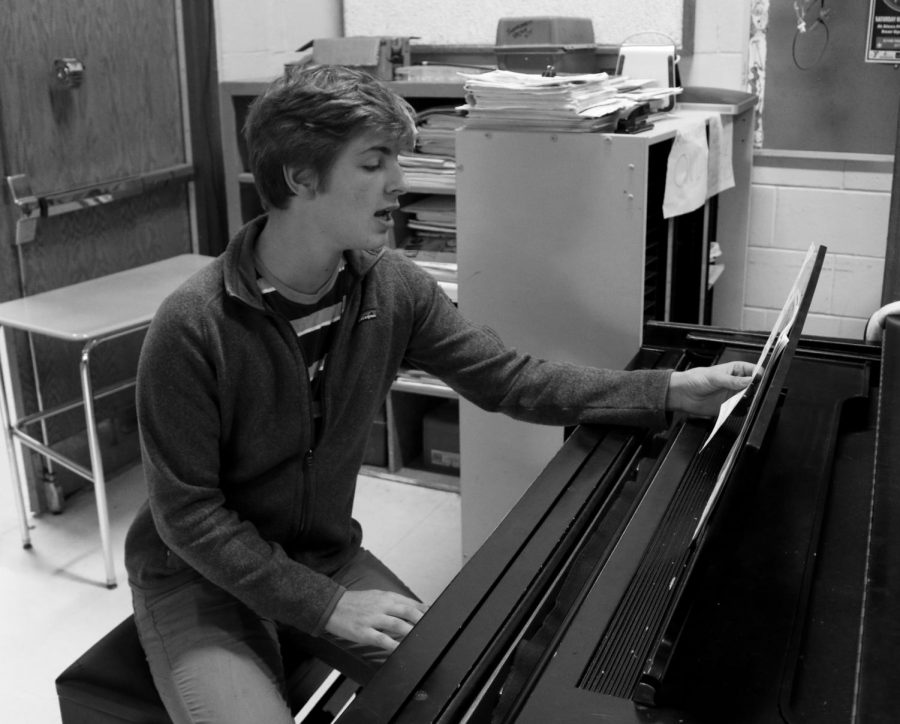 Senior Christian Schmidt works on composing music for his college portfolio.