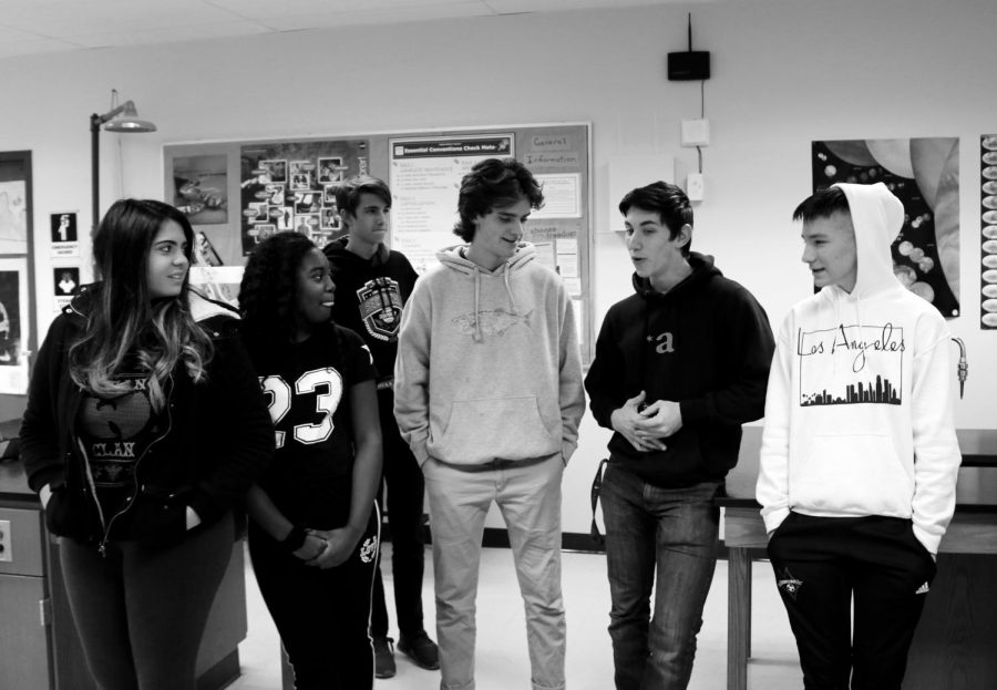 From left Lorrayne De Souza, Marsha Stewart, Zachary Utz, Graham Sterns, Senior Ian Trance, and freshman Sean Splittberger engage in a senior led group circle discussion.