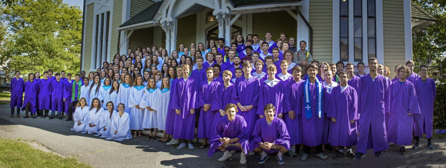 The Class of 2018 at their graduation ceremony wearing gender-specific gowns.