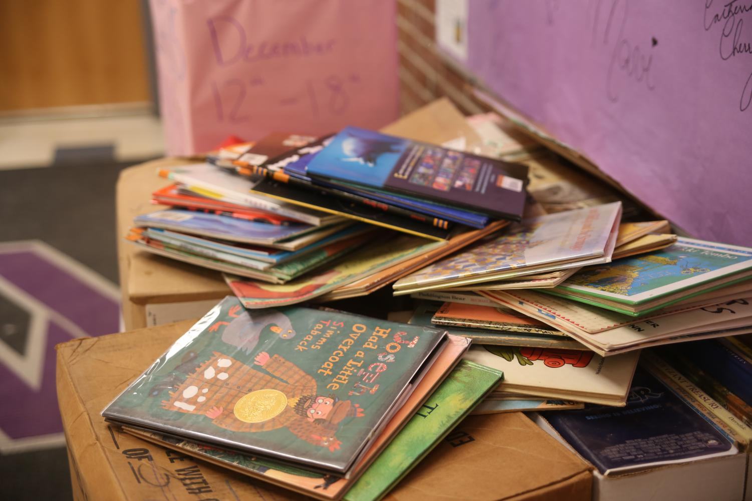 Donated books overflow from their boxes at the book drive.