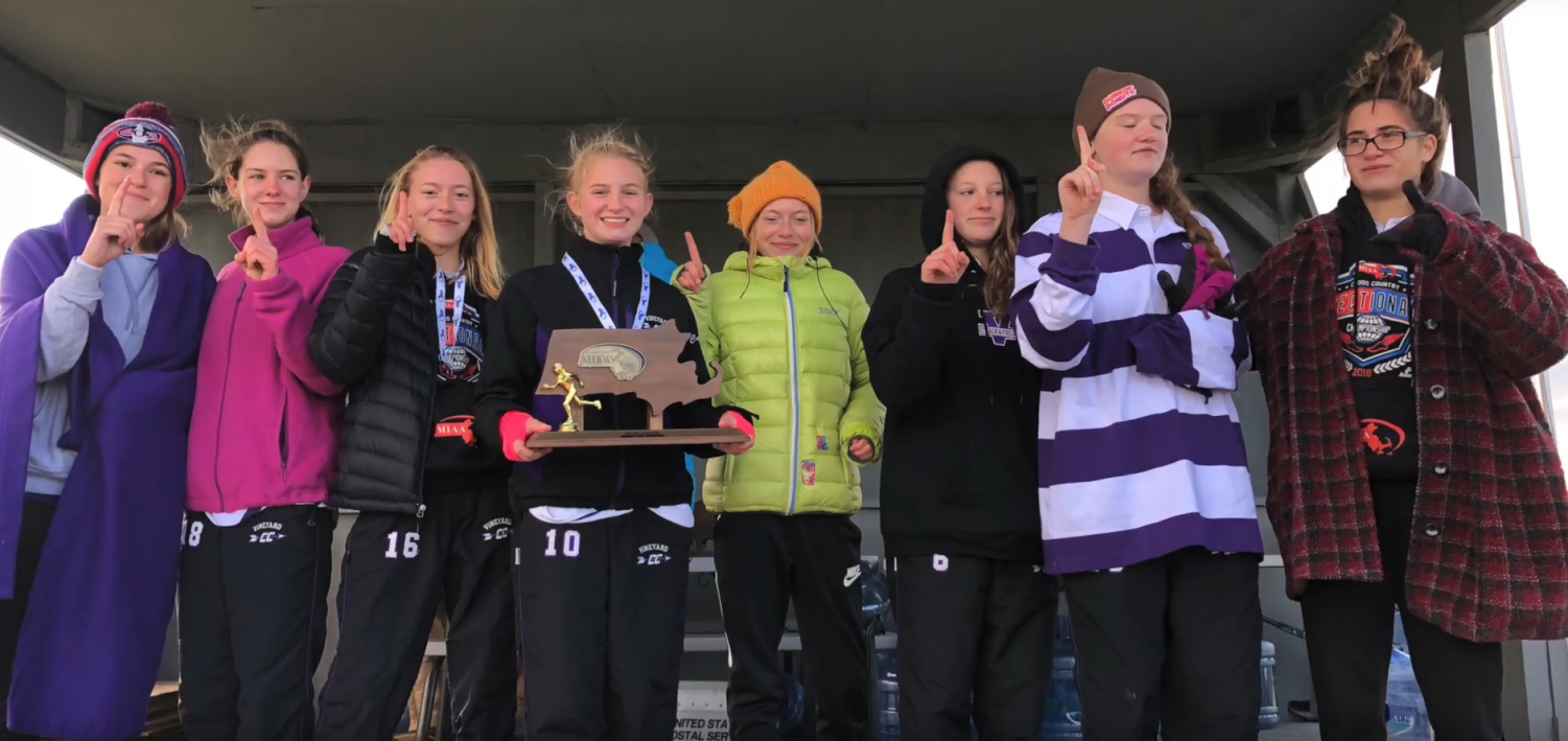 The girls cross country team stands with their championship trophy. From left, Amber Cuthbert, Katie Freeman, Wren Christy, Catherine Cherry, Eloise Christy, Ashley Biggs, Margaret Sykes, and Yayla DeChiara.