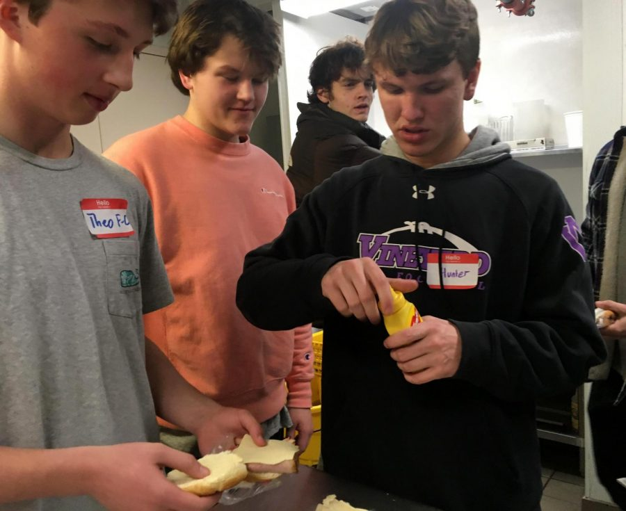 From left to right freshman Theo Fairchild-Coppoletti, seniors Max Cordray and Robert Hanjian, and junior Hunter Athearn assemble sandwiches at the CityReach program.