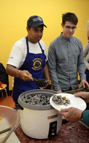 Enrique Contreras serves rice and beans to Rotary International members