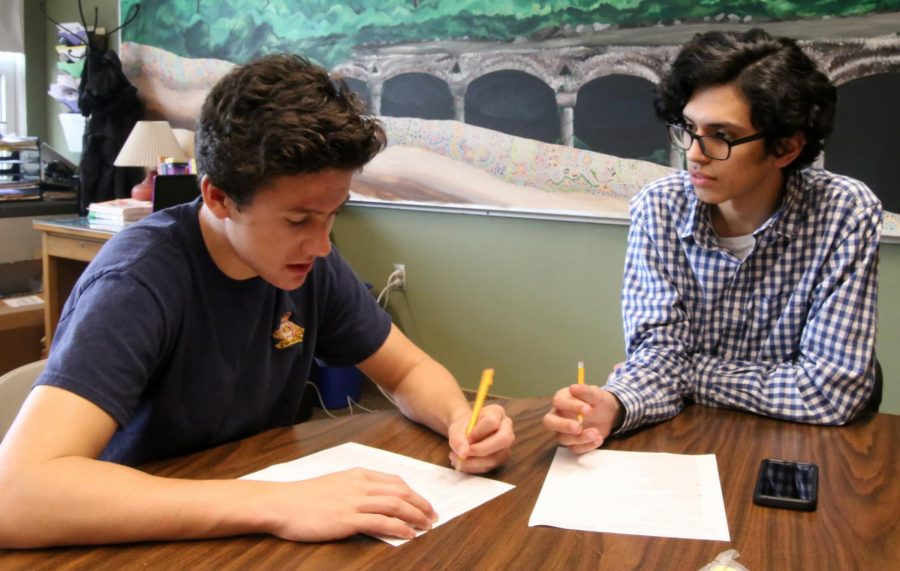 Joe Serpa and Juan Sanchez quiz each other for their bi-literacy exam.