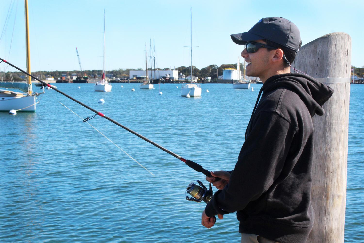 Senior Luke El-deiry fishes on the last day of the Martha's Vineyard Striped Bass and Bluefish Derby at the Owen Park pier.