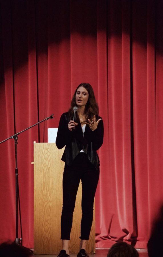 Guest+speaker+Jacqueline+Reilly+tells+her+personal+story+to+the+junior+and+senior+classes+in+the+auditorium%2C+informing+students+about+sexual+assault+and+violence.+