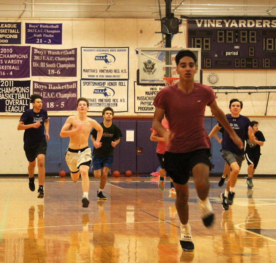 Players+on+the+boys+basketball+team+sprint+down+the+court+during+Monday%E2%80%99s+tryouts.