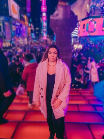 Mavi DeOliveira visits Times Square in New York City this past winter.