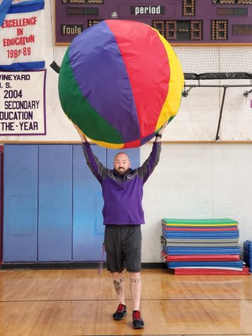 Coach Kent holds the (metaphorical) world in his hands during an adaptive PE class.